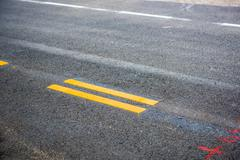 Asphalt road, yellow line on the new road Stock Photos