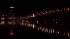 View of the night Bridge with moving cars, leaving in prospect Stock Footage