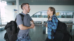 Couple of young people at the airport. Announced landing on board the aircraft - stock footage