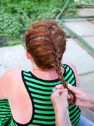 Weaving female braids Stock Photos
