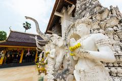 statue of Mythical male in Wat Sanpa Yang Luang, beautiful temple in Lamphun, - stock photo