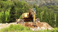 Large yellow excavator rake soil Stock Footage