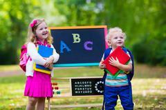 Children happy to be back to school - stock photo