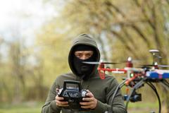 Man flying with the drone - stock photo