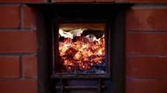 Russian bathhouse. Close-up shot of the flame in the furnace of the wood stove Stock Footage