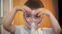 Boy smiling at the oxygen mask, inhalation Stock Footage