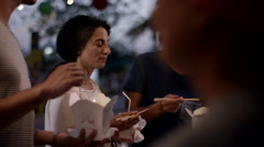 Friends eating food at park. Stock Footage