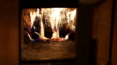 Russian bathhouse. Close-up shot of the flame in the furnace of the wood stove - stock footage