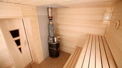 Russian bathhouse. The interior of the steam room with a wood burning stove. Stock Footage