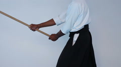 Martial arts Master in black hakama practice martial arts with wooden jo stick Stock Footage
