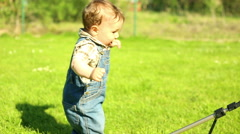 Toddler playing tripod in yard at the village - stock footage