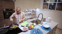 Man Adds Salt and Pepper to the Vegetables Stock Footage