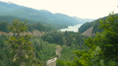 Panoramic view of ocean, mountains with spruce trees foreground Stock Footage