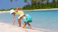 Adorable little girls at white beach during tropical vacation - stock footage