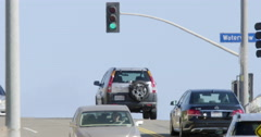 Playa del Rey traffic driving over hill near ocean in slow motion 4K Stock Footage
