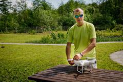 Quadrocopters preparation for flight Stock Photos