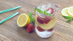 Homemade lemonade with lemon and strawberry Stock Footage