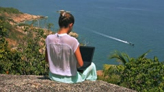 Woman freelancer working in front of breathtaking view Stock Footage