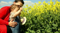 Mother learns a little son sniff the flowers Stock Footage