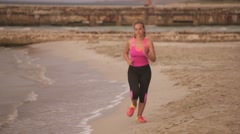 7-Active Girl Doing Fitness Running On Beach Stock Footage