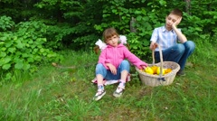 Children already gorged and do not wish to eat the fruit. Stock Footage