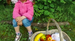 Child girl is offended and upset. The girl does not want to play and eat. - stock footage