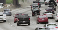 Angled view of traffic heading south on 110 freeway in Downtown LA 4K - stock footage