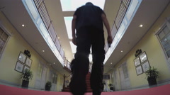 Man Walks Up Staircase In Fancy Decorative Santa Ana CA Office Building Stock Footage