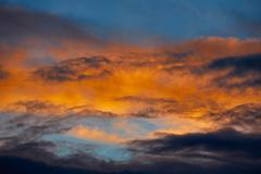 Sunset orange clouds in a blue sky Stock Photos
