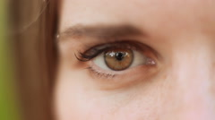 Close up view brown right eye of a female Stock Footage