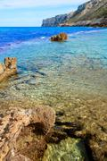 Denia Las rotas beach near Sant Antonio cape - stock photo