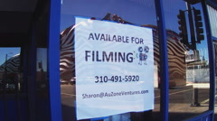 Available For Filming Sign On Coffe Shop Window- Zoom - stock footage