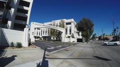 Car Entering Sony Pictures Entertainment Studios- Culver City CA Stock Footage