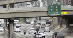 Signage at interchange as traffic heads south on 110 freeway in Downtown LA 4K - stock footage