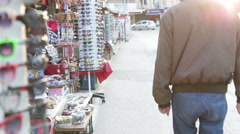 People walk on the clothing market Stock Footage