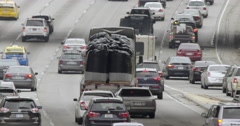 Traffic with truck full of sacks heads north on 110 freeway in Downtown LA 4K - stock footage