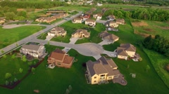 Beautiful, suburban houses and yards, early morning, aerial view Stock Footage