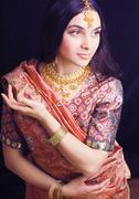 Beauty sweet real indian girl in sari smiling Kuvituskuvat