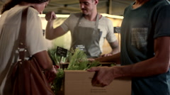 Expat couple buying vegetables at market. Stock Footage