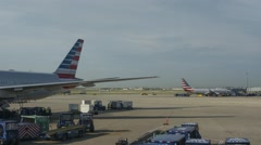 Time lapse of a busy airport ramp preparing jets for flight Stock Footage