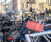 Many bicycles on street of Amsterdam city, parking ideal traffic eco healthy Stock Photos