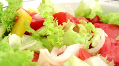 Spinning plate with fresh vegetable salad Stock Footage