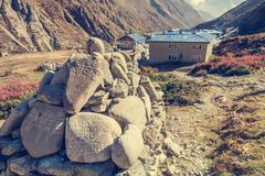 Trekking around Annapurnas and passing buddhist writings. Stock Photos