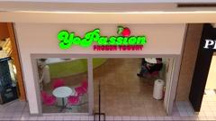 4K YoPassion frozen yogurt shop entrance Stock Footage