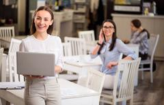 Nice smiling  woman holding laptop Stock Photos