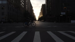 New York City block at sunset with taxi cabs and traffic - stock footage