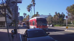 Extended Length City Busses On Wilshire Blvd- Los Angeles CA Stock Footage