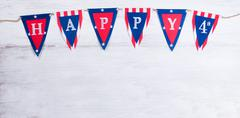 Fourth of July holiday banner on white wooden boards - stock photo