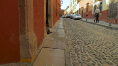 Steadicam shot of the cobblestone streets of San Miguel de Allende Mexico Stock Footage