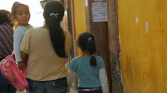 A young family walks together on the narrow streets in a colonial city Stock Footage
